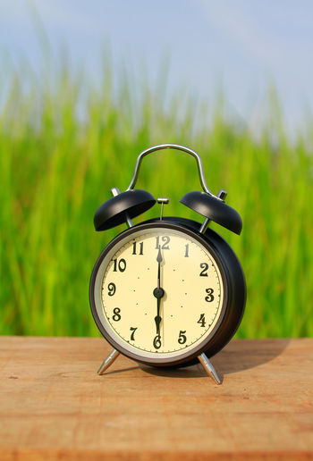 Alarm clock shows 6 o`clock isolated on green grass background. Second Vintage Clock Bell EyeEm Best Shots EyeEmNewHere EyeEm Gallery EyeEm Selects Afternoon Morning Light Objects Alarm Clock Time Retro Styled Clock Old-fashioned Bell No People Day Clock Face Minute Hand Hour Hand