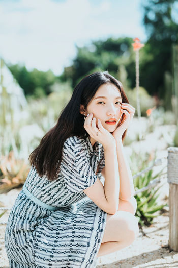 Beautiful Woman Casual Clothing Contemplation Day Females Focus On Foreground Hair Hairstyle Leisure Activity Lifestyles Long Hair Looking At Camera One Person Portrait Real People Sitting Smiling Women Young Adult Young Women