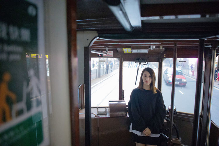 One Person Public Transportation Real People Rail Transportation Sitting Train Mode Of Transportation Looking At Camera Transportation Portrait Women Train - Vehicle Lifestyles Casual Clothing Indoors  Young Adult Leisure Activity Young Women Hairstyle Teenager Beautiful Woman Waiting