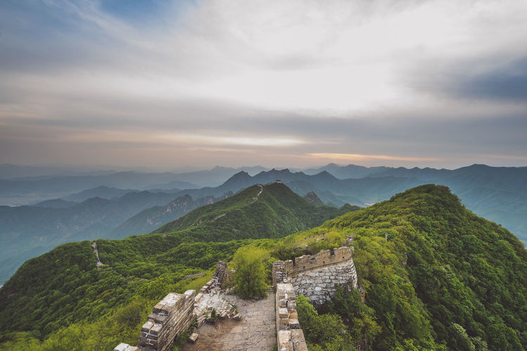 Great Wall of China, Jiankou wild and unrestored section ASIA Great Wall Great Wall Of China Nature Nikon D810 Ancient Civilization Architecture Beauty In Nature Built Structure Cloud - Sky Day Evening Sky Expore Mountains Green Color History Jiankou Mountain Mountain Range Nature No People Outdoors Scenics Sky Spring Tranquil Scene Tranquility Travel Destination Tree