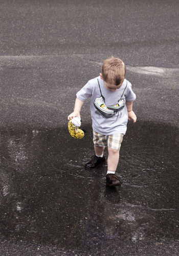 Blond Hair Boy Brown Shoes Casual Clothing Child Childhood Children Only Full Length Males  One Boy Only One Person Outdoors Puddle Splashing Puddles Sommergefühle Splashing Standing Stomping Toddler  Wet Shoes