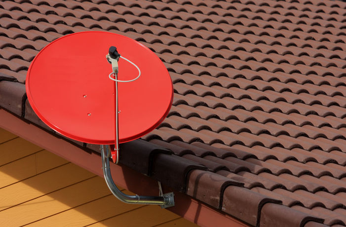 red satellite on roof Channel Dish Electronic Receive Reception Red Roof Transmission Blue Broadcast Cable Cellular Data Digital Directly Above Dual Internet Network Outdoors Program Satellite Sky Space Technology Transmit