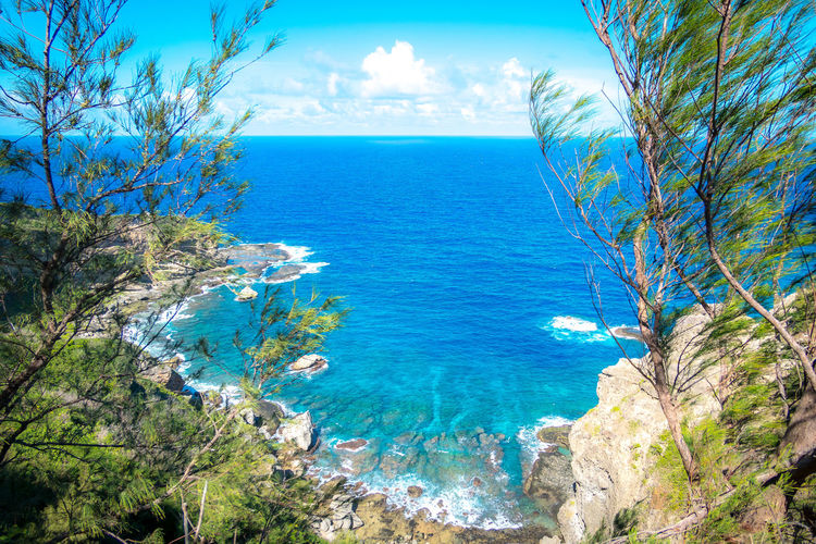 Island with natural beauty Beach Beauty In Nature Blue Cloud - Sky Day Horizon Horizon Over Water Idyllic Land Nature No People Outdoors Plant Scenics - Nature Sea Sky Tranquil Scene Tranquility Tree Turquoise Colored Water