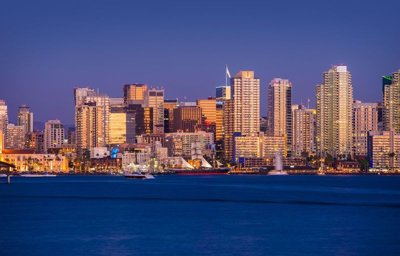 Colorful San Diego Skyline and Waterfront at Night. San Diego, California, United States. California San Diego Architecture Building Building Exterior Built Structure City Cityscape Clear Sky Illuminated Landscape Nature No People Office Building Exterior Outdoors Passenger Craft Residential District Sky Skyscraper Transportation Travel Destinations Urban Skyline Water