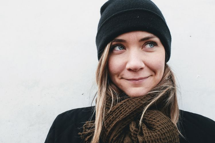 Beautiful Woman Clothing Cold Temperature Front View Hairstyle Hat Headshot Human Face Knit Hat Leisure Activity Lifestyles Looking At Camera One Person Portrait Real People Scarf Smiling Warm Clothing Winter Women Young Adult