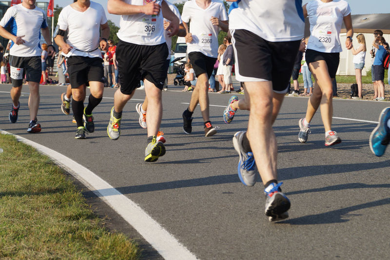 Low Section Of People Running During Marathon On Street