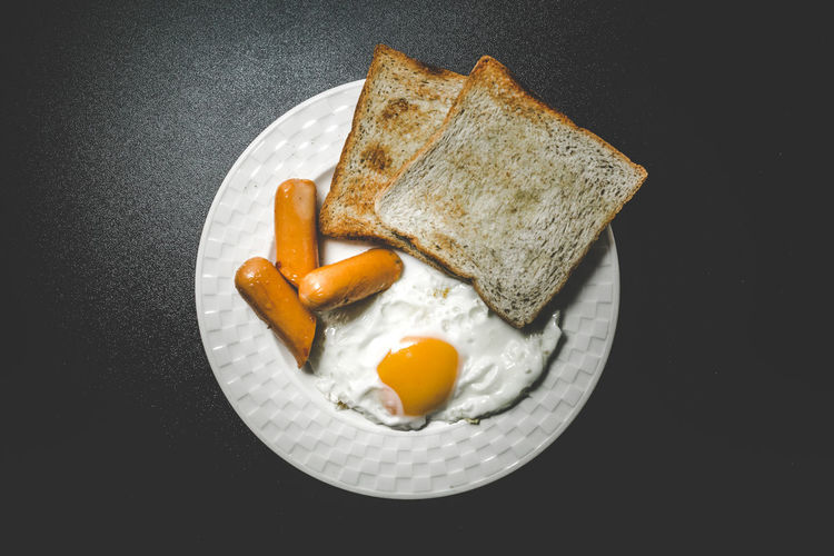 High Angle View Of Breakfast Served In Plate Over Black Background