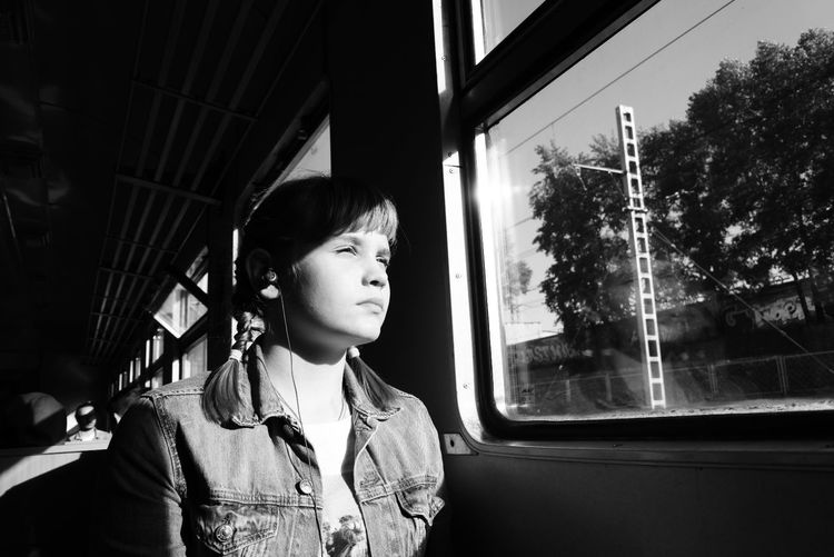Teenage Girl Sitting In Tram