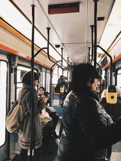 Outdoors Public Transportation Transportation Train - Vehicle Vehicle Interior Subway Train Passenger Journey Commuter Travel Rail Transportation Mode Of Transport Passenger Train City Life Black Hair Train Interior Commuter Train Real People Casual Clothing Young Adult Bus Postcode Postcards