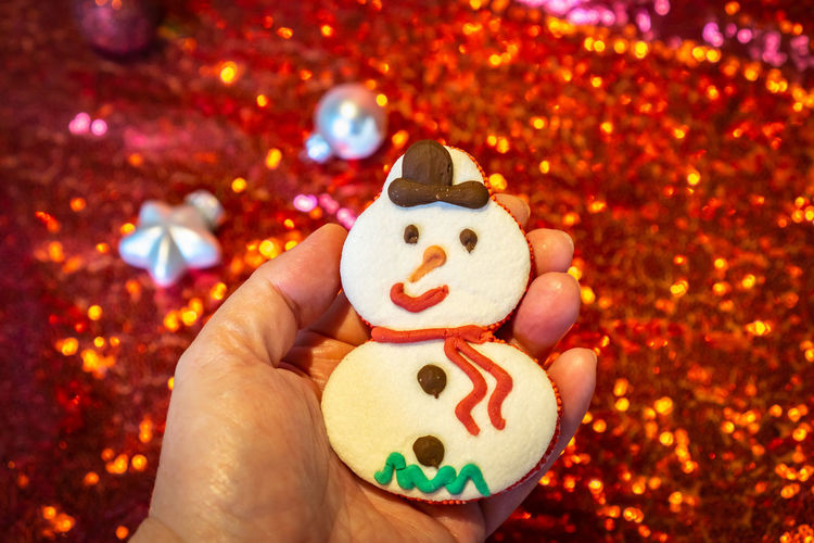 Human Hand Hand One Person Human Body Part Holding Representation Celebration Food And Drink Close-up Smiling Body Part Indoors  Food Focus On Foreground Creativity Christmas Human Representation Finger Anthropomorphic Smiley Face Snowman Christmas