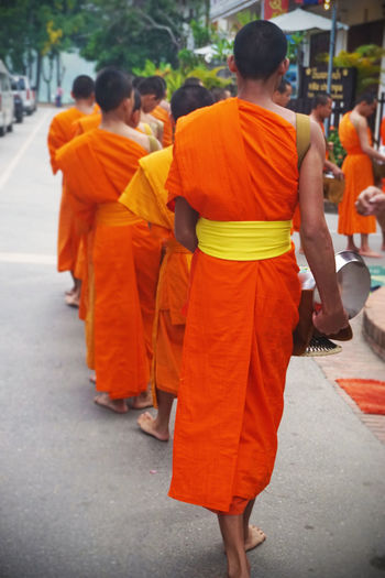 2017 Day Group Of People Laos Luang Phabang Luangprabang Men Morning Orange Outdoors Paindapatika People Real People Sanskrit Street World Heritage ラオス ルアンパバーン 御坊さん 托鉢 Religion Buddha Temple Monk