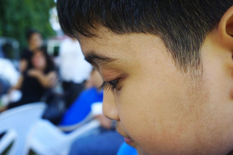 Close-up of boy at outdoor cafe