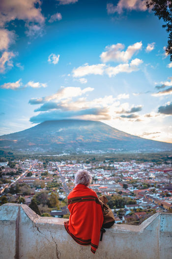 Autumn Mood Sky Cloud - Sky One Person Rear View Mountain Real People Women Nature Adult Beauty In Nature Outdoors Environment Volcano Cloud Sitting View City Cityscape Travel Travel Destinations Traveling Wanderlust Adventure Guatemala