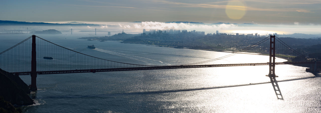 Panorama of the Golden Gate Bridge with the city of San Francisco, Yerba Buena Island, Treasure Island, and the Oakland Bay Bridge in the background Bridge Bridge - Man Made Structure City Skyline Connection Engineering Foggy Morning Golden Gate Bridge Golden Gate Park International Landmark Journey Landmark Panorama San Fancisco Bay Sunrise Suspension Bridge The Way Forward Waterfront Fine Art Photography