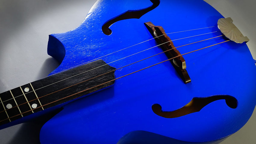 Blue mandolin. A mandolin is a popular musical instrument in country, gospel, bluegrass, and folk music. Band Chords Country Gospel Music Kentucky  Singer  Wood Arts Culture And Entertainment Blue Bluegrass Close-up Country Music Folk Music Guitar Handheld Handmade Mandolin Melody Music Musical Instrument Musical Instrument String No People Pick Sounds String Instrument