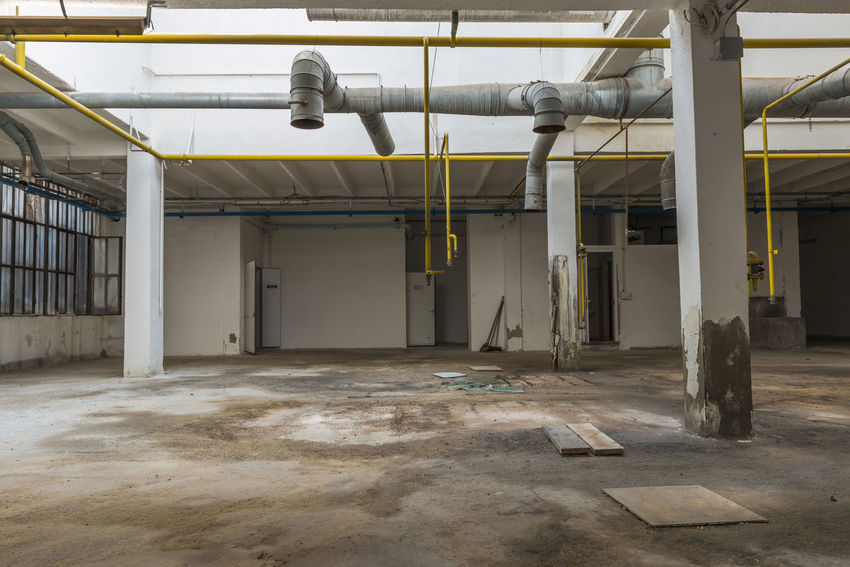 Disused empty factory space City Columns Day DISUSED Disused Building Empty Empty Space Factory Factory Building Futuristic Indoors  Industry No People Science Space Technology
