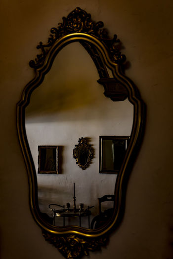 Mirror Image in Retro Style. Antique Candle Creativity Mirror Image Old Fashioned Retro Architecture Art And Craft Built Structure Close-up Creativity Decoration Design Indoors  Mirror No People Ornate Picture Frame Retro Styled Shape Wall - Building Feature