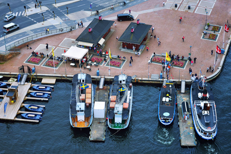 High Angle View Of Boats Moored On Sea At Harbor
