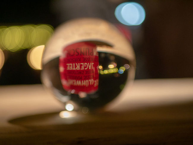 Close-up Selective Focus No People Indoors  Focus On Foreground Table Still Life Refreshment Red Wood - Material Text Drink Bottle Single Object Alcohol Western Script Circle Food And Drink Glass - Material Wine