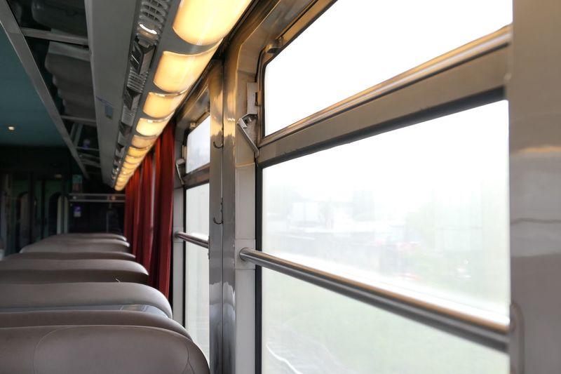 Seats by window in train