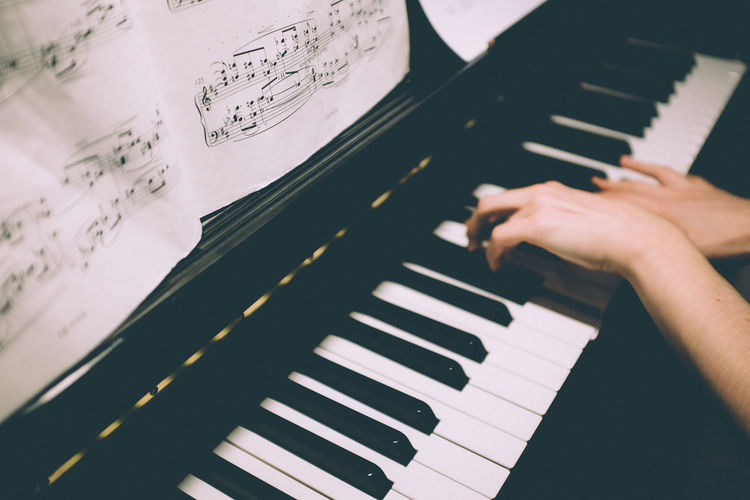 Arts Culture And Entertainment Classical Music Close-up Day Human Body Part Human Hand Indoors  Music Musical Instrument Musical Note Musician One Person People Performance Pianist Piano Piano Key Playing Real People Sheet Music Skill