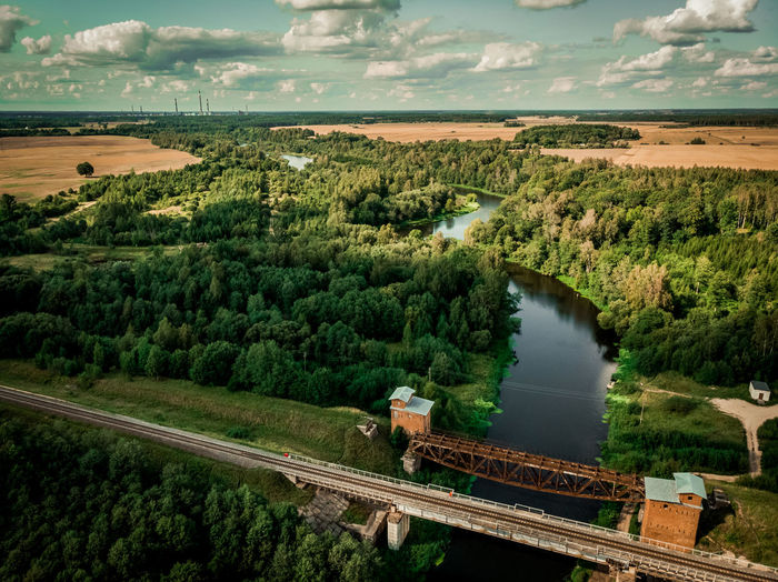 Abandoned railway bridge Dark Water River Bridge Drone  Dronephotography Drone Photography Droneshot Aerial Aerial View Grass Above Above The Ground EyeEm Selects Look Boy Lithuanian Lithuanianboy Lake Lake View Lakeshore Green Color Green Shore Shoreline Aerial Shot Above The Lake Lithuania Lietuva Water Tree Agriculture Rural Scene High Angle View Working Sky Landscape Cultivated Land Crop  Farmland Summer In The City