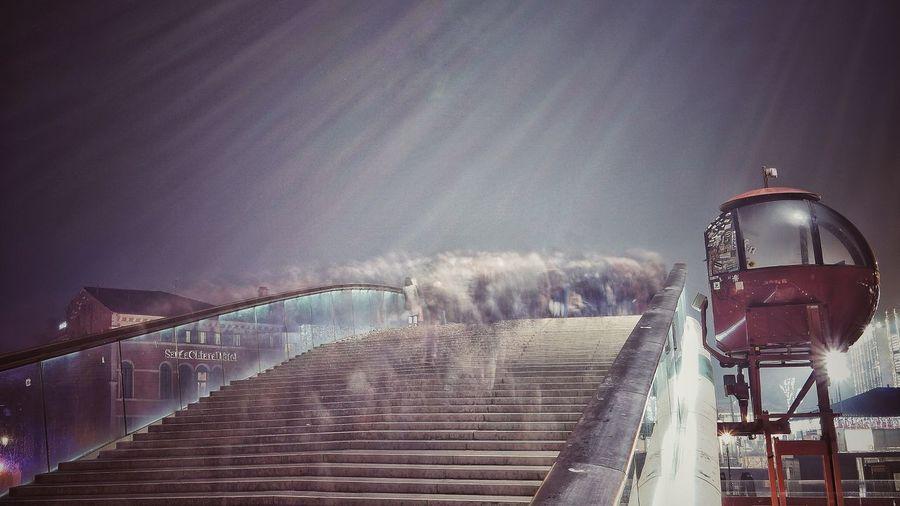 Panoramic view of illuminated bridge against sky