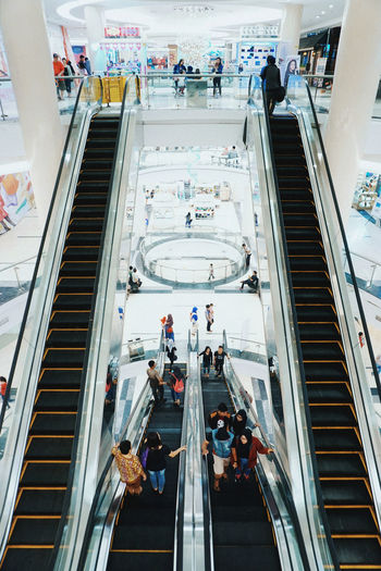 High angle view of people on escalator at subway station
