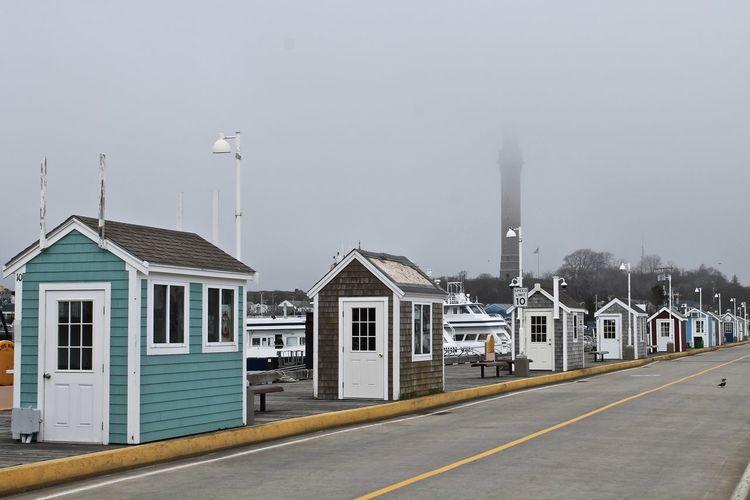 Wooden market shops along fishing pier in new england art colony