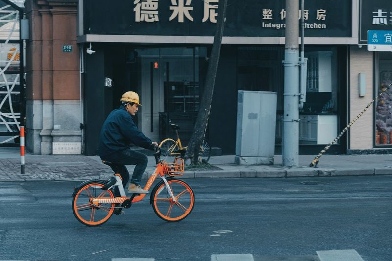 Worker Mobike Shared Bicycle In The Morning Architecture City Transportation One Person Real People Street Building Exterior Bicycle Built Structure Lifestyles City Life Adult Mode Of Transportation Land Vehicle Full Length Leisure Activity Clothing City Street Women Outdoors