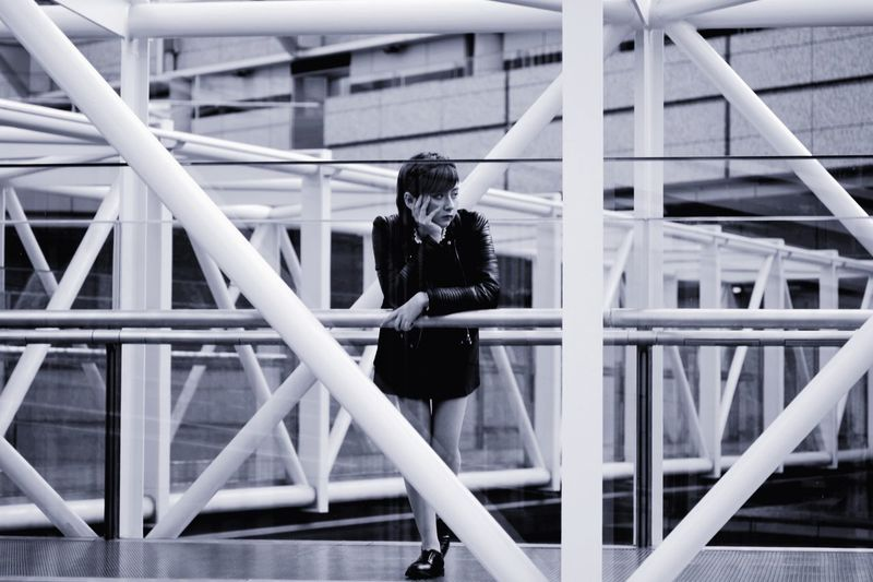 Woman looking away while sitting on staircase