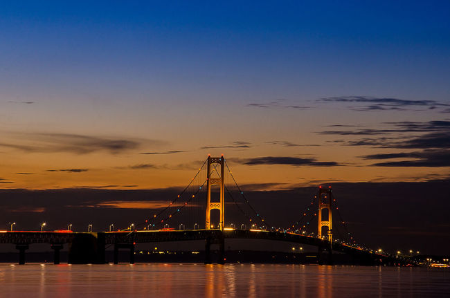 Dusk at the Mackinac Strait Mackinac Bridge Architecture Built Structure Connection Engineering Illuminated Nature Night Outdoors Sunset Suspension Bridge Transportation Travel Destinations Water Architecture Built Structure Connection Engineering Illuminated Nature Night Outdoors Sunset Suspension Bridge Transportation Travel Destinations Water
