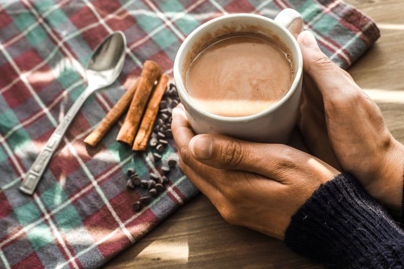 Winter Sweater Sweaterweather Cold Sunbeams Chocolate Chip Chocolate Christmas Cinnamon Sticks Hot Chocolate Human Hand Hand Food And Drink Drink Human Body Part Cup Coffee One Person Coffee Cup Mug Coffee - Drink Holding Refreshment Food High Angle View Indoors  Adult Hot Drink Personal Perspective Breakfast