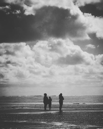 Monochrome Photography Cloud - Sky Sky Two People Black And White Rear View Outdoors Day Silhouette Real People Nature Bonding Domestic Animals Men Togetherness People Adult Vertical Baby Stroller Only Men Person