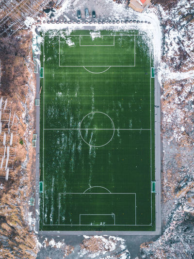 Top view of soccer field in Lofoten Islands Sport Soccer No People Day Architecture Built Structure Outdoors Playing Field Green Color Wall - Building Feature Soccer Field Team Sport Wall Blackboard  Building Exterior Stadium Directly Above Competition Board Nature Norway Field Green Lofoten Match - Sport
