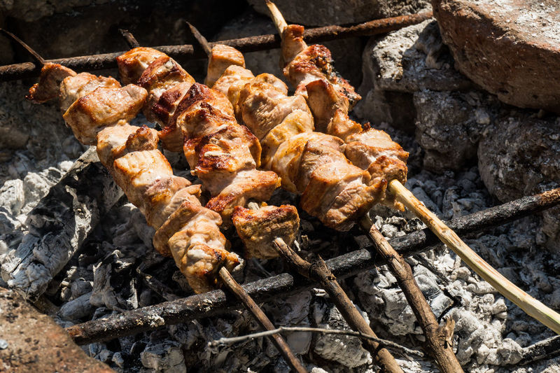 High Angle View Of Meat Skewers On Barbeque