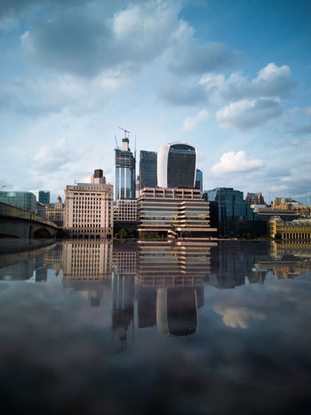 Shot with the Honor 10. City Exploring EyeEm Best Shots London Mirror Reflection Architecture Bridge - Man Made Structure Building Exterior Built Structure City Cloud - Sky Day Financial District  Honor 10 No People Office Building Exterior Outdoors Reflection Reflections Sky Skyscraper Streetphotography Travel Destinations Waterfront