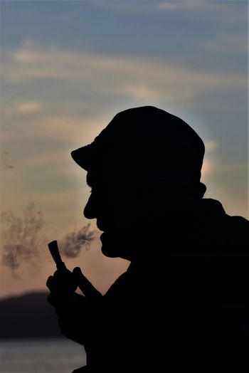 Bursa Tobacco Cloud - Sky Communication Gesturing Gölyazı Hand Sign Headshot Holding Leisure Activity Lifestyles Men Nature One Person Orange Color Outdoors Pipe Pipo Portrait Profile View Real People Side View Silhouette Sky Sunset