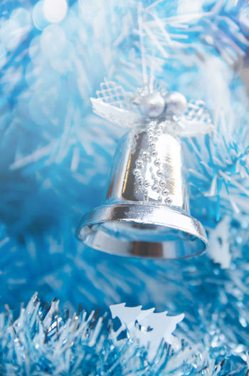 Close-up of bell hanging on christmas decoration
