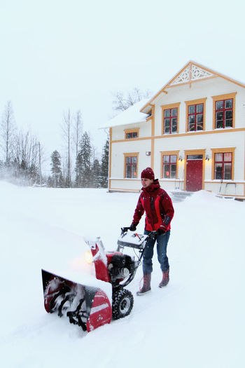 Full length of child on snow during winter