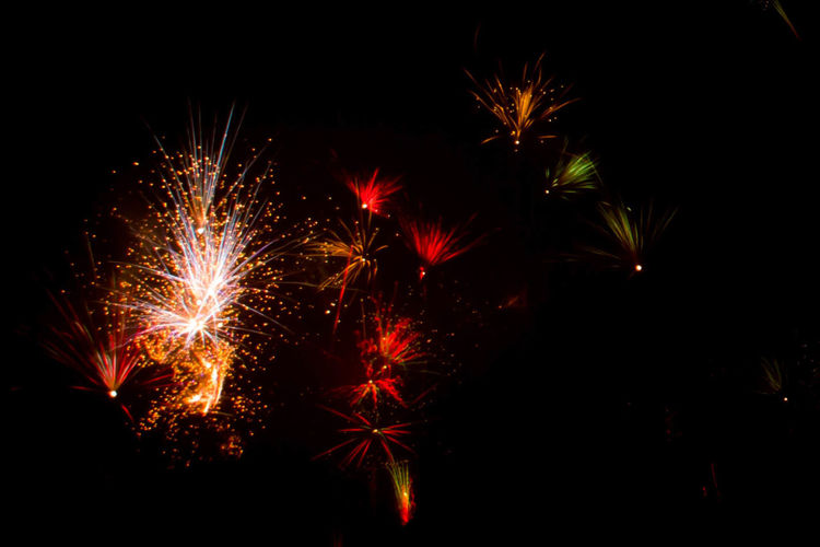Celebration Illuminated Firework Night Motion Event Arts Culture And Entertainment Firework Display Exploding Glowing Long Exposure Light No People Nature Sky Firework - Man Made Object Blurred Motion Multi Colored Low Angle View Outdoors Dark Sparks Festival