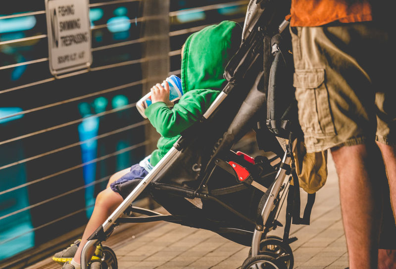 Family Father's Day Baby Stroller Casual Clothing Child Safety Childhood City Close-up Day Family Values Father Fathers Day Hetersexual Lifestyles Low Section Men Mode Of Transport One Person Outdoors Real People Riding Sitting Stroller Stroller Saferty Transportation