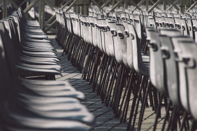 Empty chairs in a row at st peters square