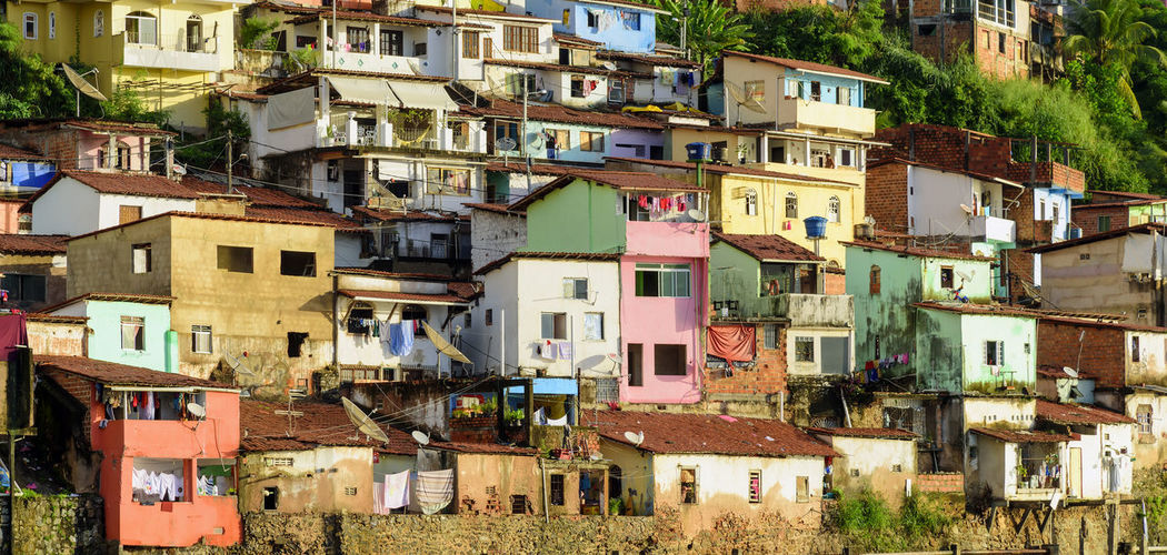 Contour shantytown with its colorful houses on the hill by the sea in the city of Salvador in Bahia, Brazil Bahia Brazil Colored Community Salvador Agglomeration Architecture Building Exterior Colorfull Dirt District Favela Ghetto Hill House No People Outdoors Poverty Sea Slum Social Issues Town Underprivileged Urban