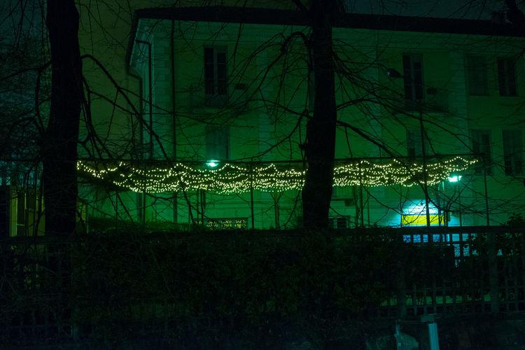 Illuminated lighting equipment on building at night