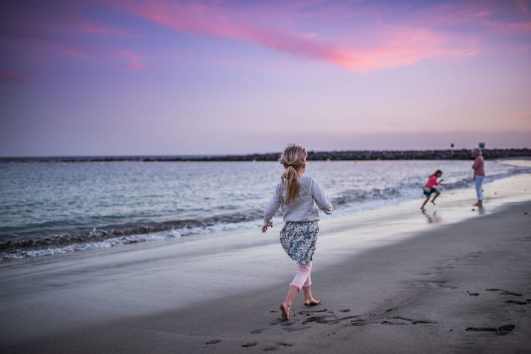Beach Beuty In Nature Childhood Evening Full Frame Playing Purple Running Sand Scenics Sea Sunset Water Waves