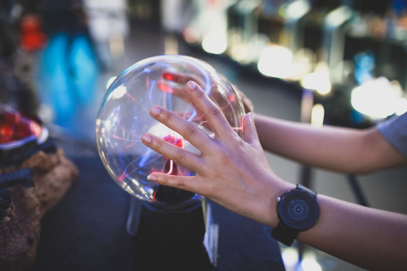 Close-up of hand holding bubbles