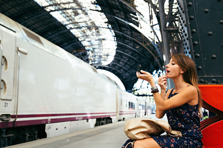 Adult Adults Only Beautiful People Beautiful Woman Beauty Blond Hair City City Life Day Happiness Lifestyles One Person One Woman Only One Young Woman Only Only Women Outdoors People Public Transportation Real People Smiling Train - Vehicle Transportation Travel Destinations Young Adult Young Women