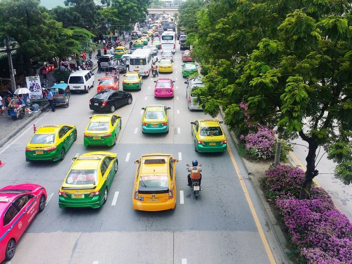 Lolipop Lolipoptaxi Candytaxi Flower Jjmarket Jjmarketthailand Jatujak Market Thailand Thailandtravel City Tree Motorcycle High Angle View Traffic Traffic Jam Vehicle Rush Hour Yellow Taxi Moving Taxi Roadways Street Scene Bus EyeEmNewHere