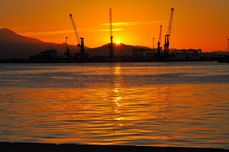 Amazing Sunset Sardegna, Cagliari Porto Sardinia, Italy Architecture Beauty In Nature Cagliari, Porto Italy Top Shot! Orange Color Outdoors Porto Di Cagliari Reflection Sardinia, Port Of Cagliari Silhouette Sun Sunset Water Waterfront